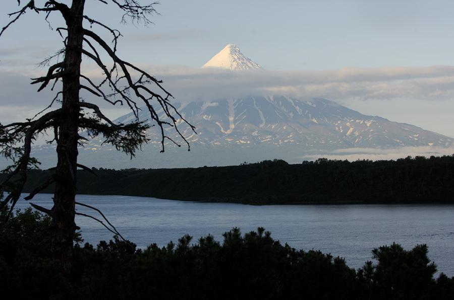 Kronotsky Volcano and dark riverbank