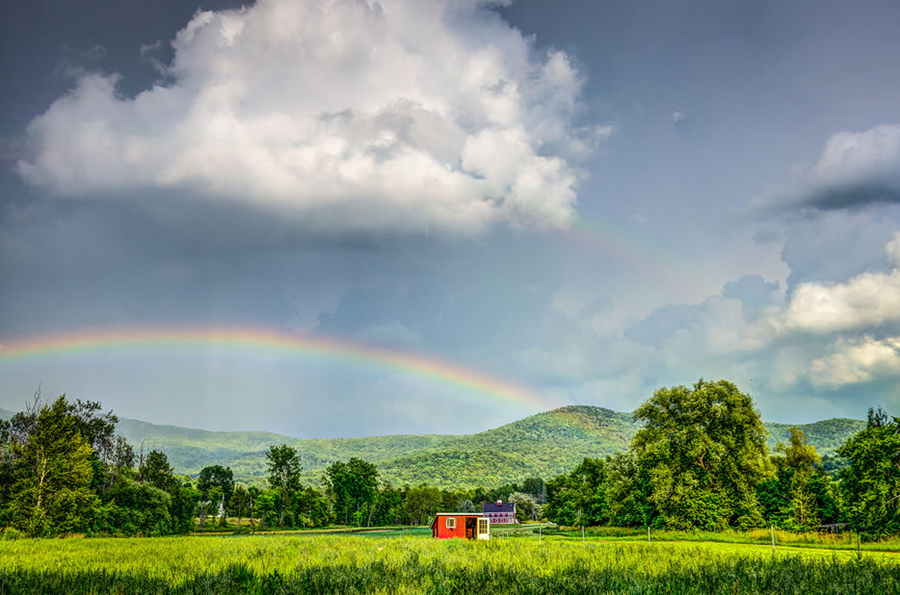 """The photographer wrote, """"A double rainbow on the 4th of July? How awesome is this?"""" Recall that seeing the second rainbow phenomenon can be difficult? """"We just got the edge of a storm that came through and I happened to go outside and saw this rainbow. Then when I was editing it, I noticed the double rainbow. The only way I could show the second rainbow was to lower the exposure which made me do a HDR process."""" Photo #30 by Nicholas Erwin"""