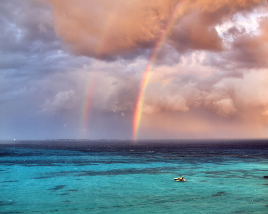 """Double rainbow during a stormy Cancun afternoon. """"Dare to love yourself as if you were a rainbow with gold at both ends,"""" wrote Aberjhani in The River of Winged Dreams. Photo #4 by purolipan"""