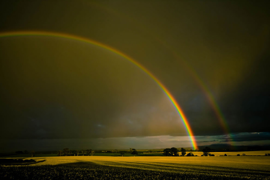 Double rainbow over the Merse, Scotland. After the great flood and Noah's famous Ark, came a rainbow that God said is His promise never to flood and destroy the entire earth again. But rainbows are so spectacular, that these multicolored arcs are woven into all kinds of legends, folklore, mythology and religions. Photo #7 by Neal Fowler