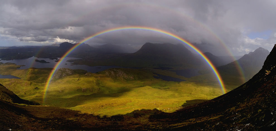 """The photographer wrote, """"Just as we reached the saddle of Stac Polaidh we were rewarded with the best rainbow(s) I have ever seen. Looking north across Loch Sionascaig to Suilven. Cul Mor and Cul Beag to the right."""" Photo #13 by David Ian Roberts"""