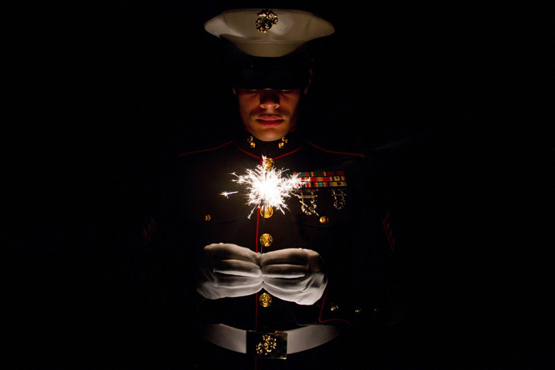 Marine-holding-a-sparkler-celebrating-July-4th