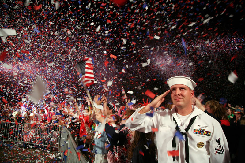 Sailor-salutes-as-the-American-flag-is-presented-on-stage-during-the-Boston-Pops-Fireworks-Spectacular-at-the-Charles-River-Esplanade-July-4th