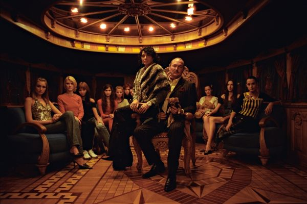 Businessman Andrei Chizhik and his wife Julia onboard his ship ÒChizhikÓ in an environment of participants of television reality-show ÒSupermodel of RussiaÓ which shooting pass. in magnificent interiors of the vessel.. Moscow,  Russia, 15.10.2004