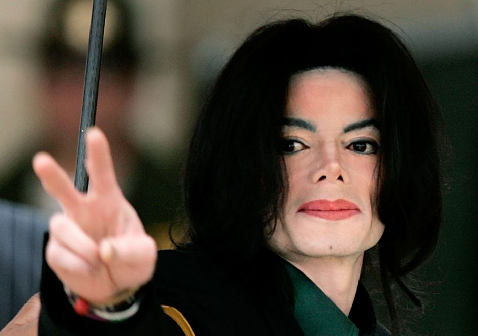 SANTA MARIA, CA - MARCH 2: Michael Jackson arrives at the Santa Barbara Court House before the third day of his child molestation trial March 2, 2005 in Santa Maria, California. Jackson is charged in a 10-count indictment with molesting a boy, plying him with liquor and conspiring to commit child abduction, false imprisonment and extortion. He has pleaded innocent. (Photo by Carlo Allegri/Getty Images)